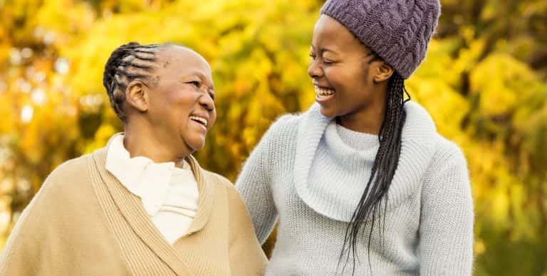 african-american-mother-and-daughter-walking