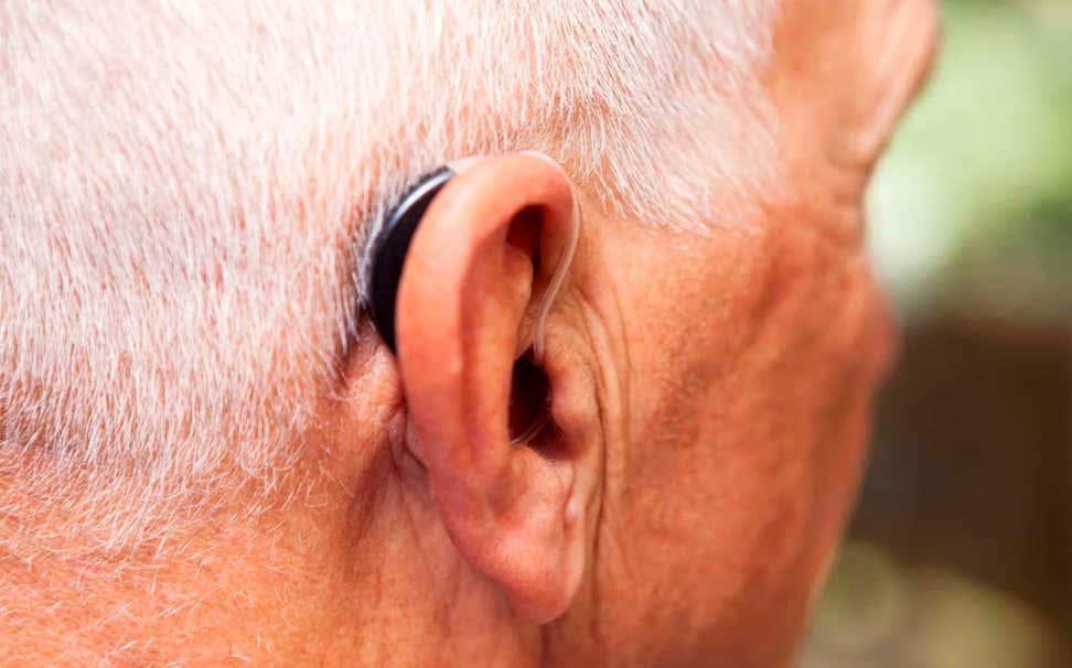 Senior man with hearing aid