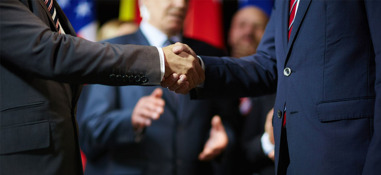 politicians-shaking-hands_Hero_iStock-622974314_2020-12_1336x614.jpg