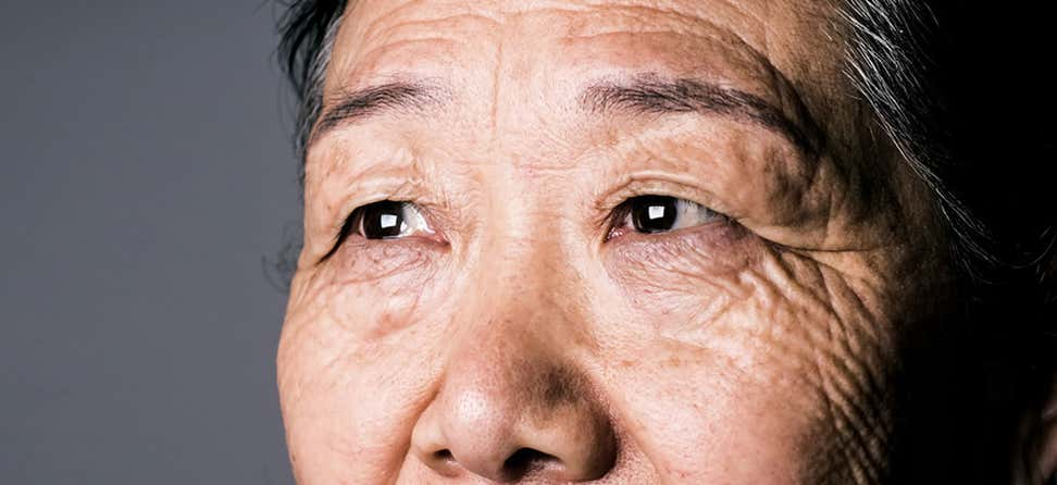An up close shot of a senior Asian woman's eyes.