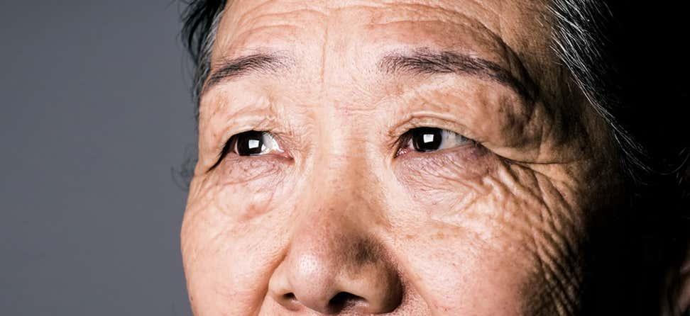 An up close shot of a senior Asian woman's eyes.
