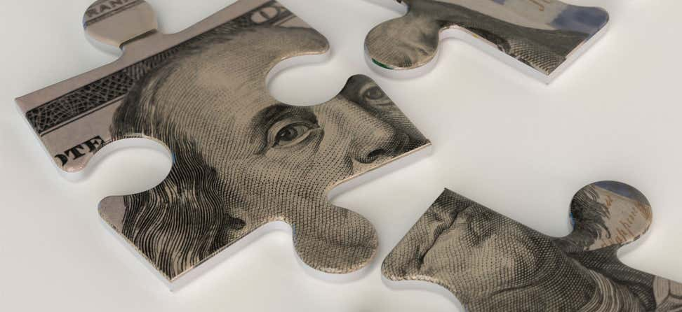 A close-up of a hundred dollar bill puzzle, with the majority of Ben Franklin's face showing.