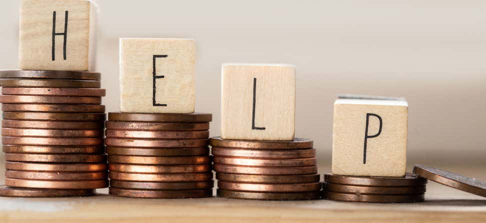 "A line of wooden cubes with the word ""Help"" and pile of coins are staircased to signify how to boost your budget."