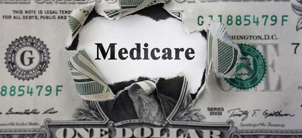 Medicare inside torn dollar bill