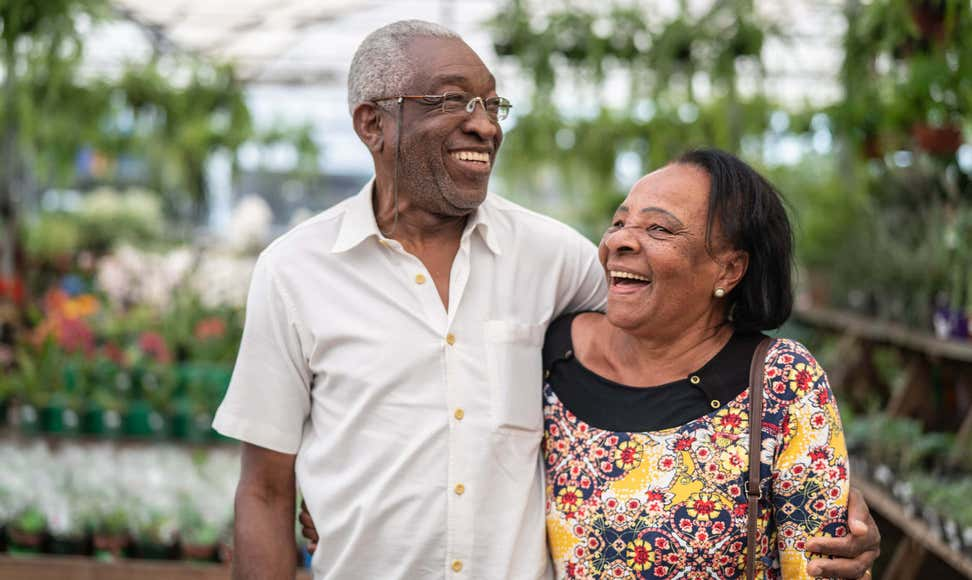 Senior AfricanAmerican couple exploring a greenhouse together.