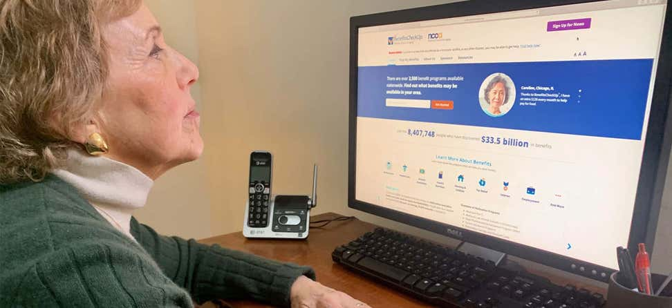An older caucasian woman is reviewing her options on NCOA's BenefitsCheckUp website.