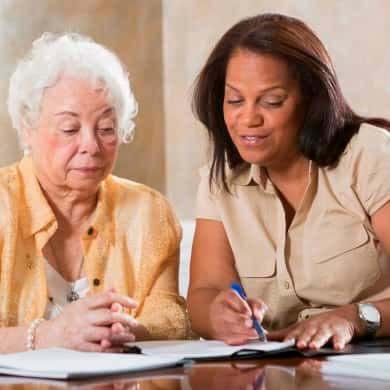 Senior woman getting benefits counseling