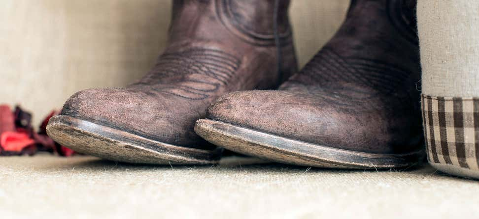 An upclose shot of the toe box of a pair of brown cowboy boots.