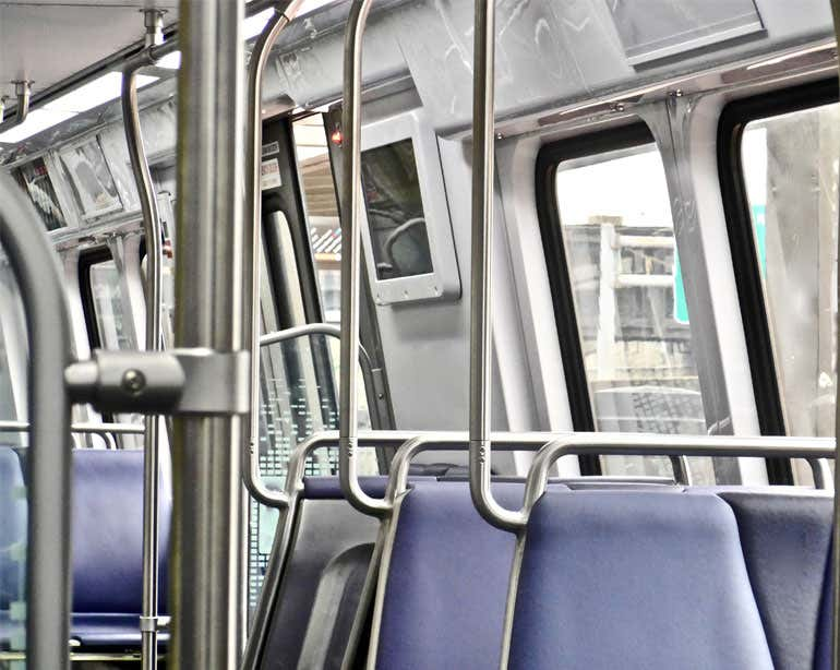 An empty DC Metro rail car interior.