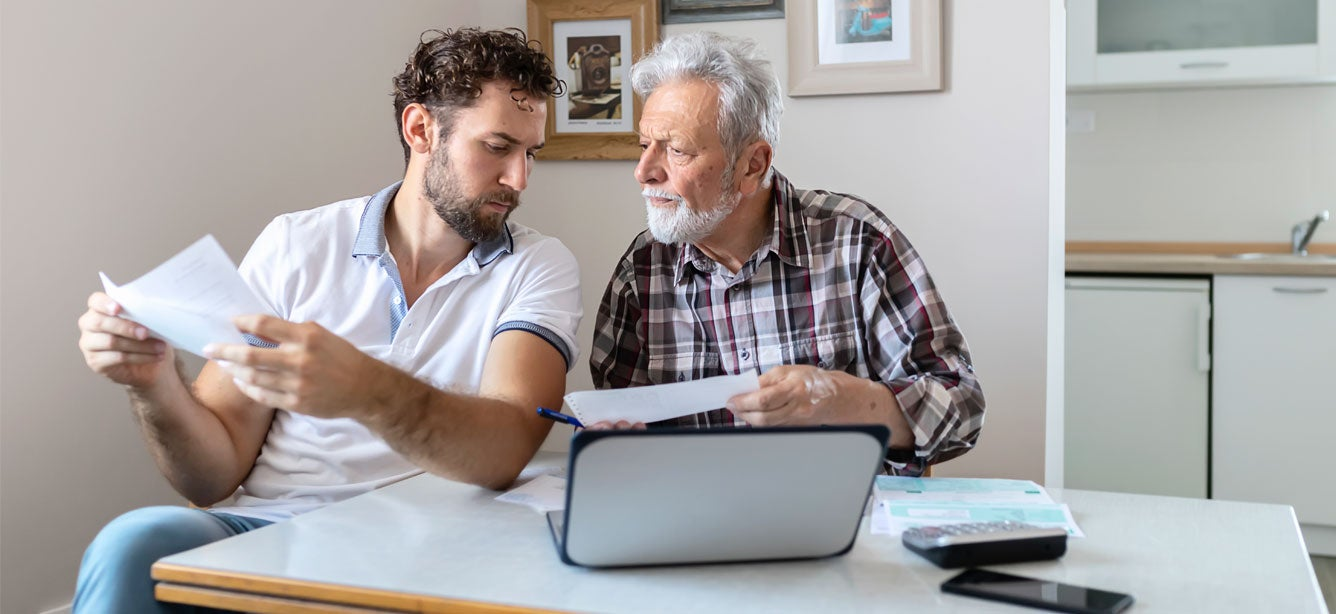 A senior father and his son are discussing his financial troubles and trying to figure out a budget.
