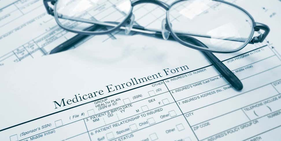 Glasses on top of a Medicare Enrollment Form