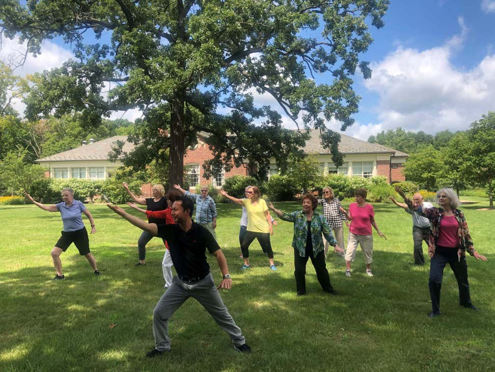 A group of seniors is practicing Tai Chi outside. NISC Photo Contest (image by Tara Purtell)