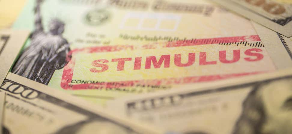 "A close up shot of U.S. Treasury check stamped with the word ""stimulus""."