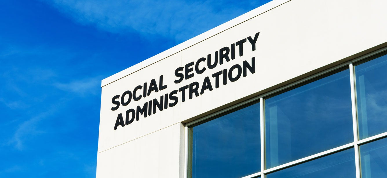 A closeup shot of a Social Security Administration sign on field office building.