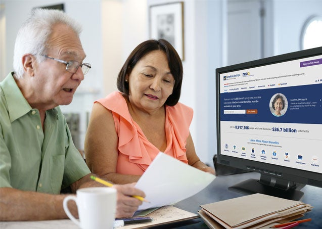 A senior couple is working together to figure out what Medicare benefits they are eligible for via BenefitsCheckup.org.