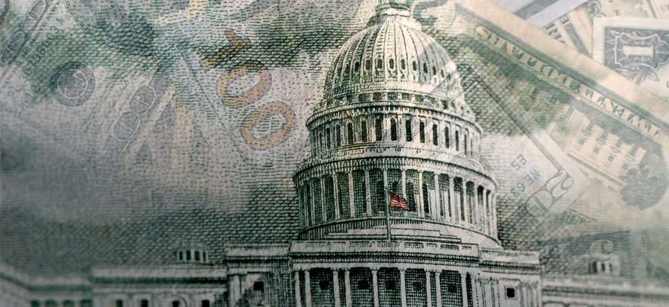 U.S. printed money overlays an external shot of the rotunda at the U.S. Capitol.